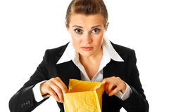 Interested modern business woman checking parcel Stock Photography