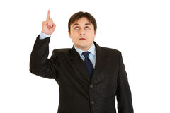 Interested modern businessman pointing finger up Stock Photos