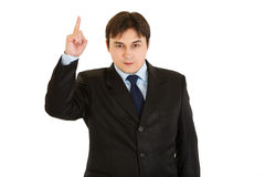 Interested modern businessman pointing finger up Royalty Free Stock Photography