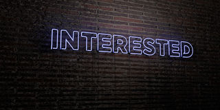 INTERESTED -Realistic Neon Sign on Brick Wall background - 3D rendered royalty free stock image Stock Image