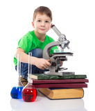 Interested small boy with microscope Stock Photography