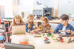 Interested team of young inventors Royalty Free Stock Photos