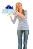 Interested teengirl shaking present box Stock Image