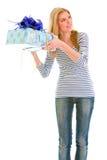 Interested teengirl shaking present box Stock Image