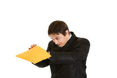 Interested young businessman checking parcel Royalty Free Stock Images