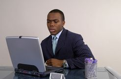 Interesting. A businessman looks with interest at his computer screen Stock Photo