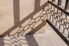 Interesting abstract background with shadow from iron on the wall. stock photo