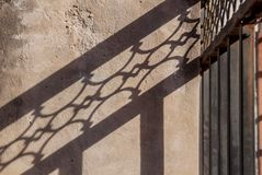 Interesting abstract background with shadow from iron on the wall. royalty free stock image