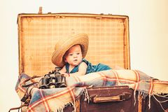 Interesting activity. Family. Child care. Small girl in suitcase. Traveling and adventure. Sweet little baby. New life. And birth. Portrait of happy little royalty free stock photo