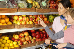 Interesting boy with mom   in the store Royalty Free Stock Images