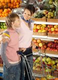 Funny boy with mom   in the store Royalty Free Stock Photos