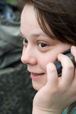 Interesting call. Outdoors portrait of young adult woman interestedly calling on the street Stock Image