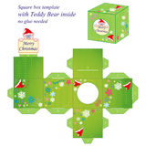 Interesting Christmas box template. Interesting square box template with cute Teddy Bear inside, holding note Merry Christmas, box without gluing Stock Image