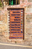 Interesting Colourful Signage, Deia, Mallorca. A ceramic direction and information board set into a street wall in the idyllic village of Deia, Mallorca Royalty Free Stock Image