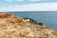 Interesting rock formations by a clear blue sea. Interesting and cool rock formations, part of the petrified forest on the south coast of Australia. Orange and stock photos