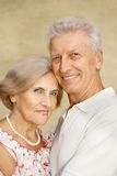 Interesting elderly couple went for a walk Stock Photo