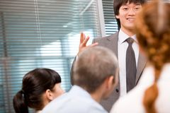 Interesting explanation. Photo of several employees during presentation with focus on their leader stock image
