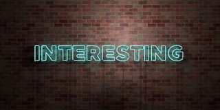 INTERESTING - fluorescent Neon tube Sign on brickwork - Front view - 3D rendered royalty free stock picture Stock Images