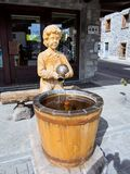 Interesting fountain of water in the Italian mountains Royalty Free Stock Photos