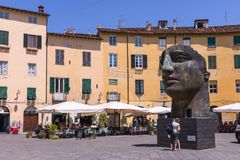 Interesting head Scuplture of the artist igor mitoraj standing in lucca. Interesting head Scuplture of the artist igor mitoraj, standing on the famous Piazza Royalty Free Stock Photography