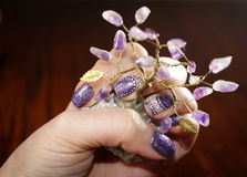 Interesting holiday nail art design with purple glitter Stock Images