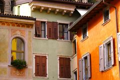 Comfort of old Europe. Interesting impressive unusual photo of some old European architecture: a few ancient close up standing buildings, bright orange, soft stock images