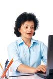 Interesting Information. Elder surprised woman using laptop on white background Stock Image