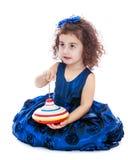 Interesting little girl spinning dreidel Stock Image