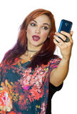 Interesting looking girl making selfie Royalty Free Stock Image