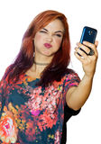 Interesting looking girl making selfie Stock Photography