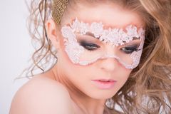 Interesting makeup and hairstyle using a lace mask Royalty Free Stock Images