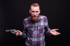 Interesting man holds weapon royalty free stock image