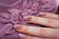 Interesting manicure in tone of clothes Stock Images