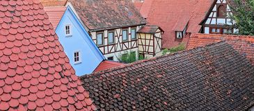 Interesting mash up of Red Tiled Medieval Roofs royalty free stock images