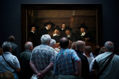 Interesting moment. An interesting moment at Rijks museum, Netherland. Showing coincident interaction between the Rembrandt`s painting master piece `Syndics of Stock Photos