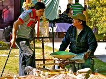 Interesting News, mexican market. Two market vendors having a good time reading the news. Market at San Miguel de Allende, Mexico Royalty Free Stock Images