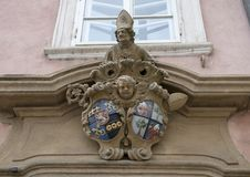 Interesting old sculpture above a doorway in Prague, capital of the Czech Republic. Pictured is an interesting old sculpture above a doorway in Prague, the royalty free stock photography
