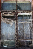 Interesting old window. Old window in an old house Royalty Free Stock Photo