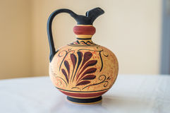 Interesting pattern on clay pot. Interesting pattern on empty clay pot on white table Stock Image