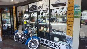 Interesting pawn shop in Broadbeach with a motorcycle outside ready for someone to purchase royalty free stock images