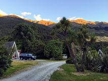 A interesting and remote place to vacation outside of Makarora with the Makarora Mountains shining in the background royalty free stock photography