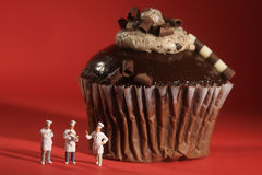 Interesting Rendition of Miniature Chefs With Cupcake Royalty Free Stock Photos