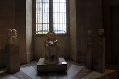 Interesting sculptures set on pedestals, seen in one of many exhibits, The Louvre, Paris, France, 2016 Stock Photo
