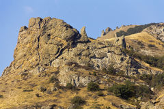 Interesting shapes of the rocks,formed by lava of an extinct volcano Kara-Dag. Royalty Free Stock Image