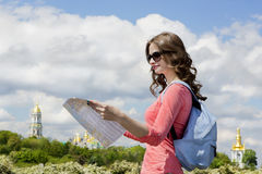 Interesting sightseeing city guide tour to Kiev. Beautiful young girl with a tourist map walking route attractions in Kiev the capital of Ukraine stock photo