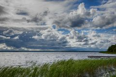 Interesting sky at the time of weather change on the lake. A large lake with clear water and beautiful vegetation surprises our imagination, the lake is Stock Image