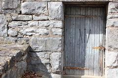 Interesting stone building with carved wood door Stock Photo