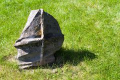 An interesting stone in home garden. An interesting rock stone in home garden royalty free stock images