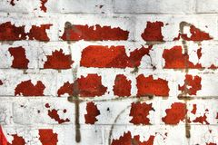 Interesting structure of a red stone wall with paint residues for abstract backgrounds. stock photography