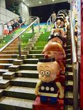 Stairs with dolls in Hong Kong stock images